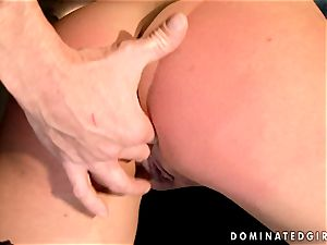 Dark haired chick gets bound and backside drilled by a cracking pink cigar