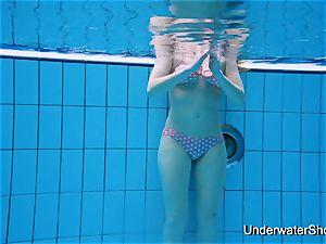wondrous woman flashes luxurious assets underwater