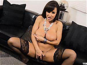 Lisa Ann shoves her dildo deep in her wet muff