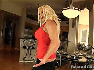 Buff damsel slips ebony faux-cock in her moist twat