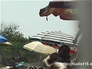 warm nude doll spied beach voyeur