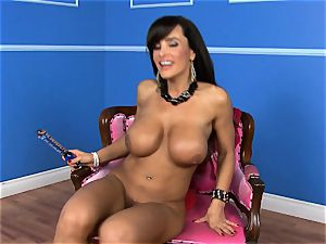 stunning Lisa Ann catapults her fake penis deep in her humid muff