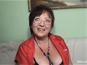insatiable mature keeps her stocking on for poking