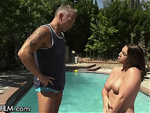 waving Housewife splashes All Over Poolboy's trouser snake