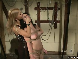 A muddy basement with super-steamy mistress Nikky Thorne