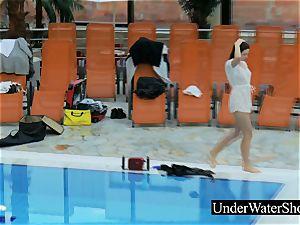 uber-sexy ginger-haired in the white sundress underwater