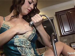 Taylor Vixen plays with her muff in the kitchen drown